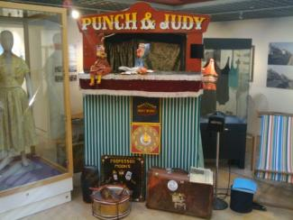 Punch and Judy on the booth playboard